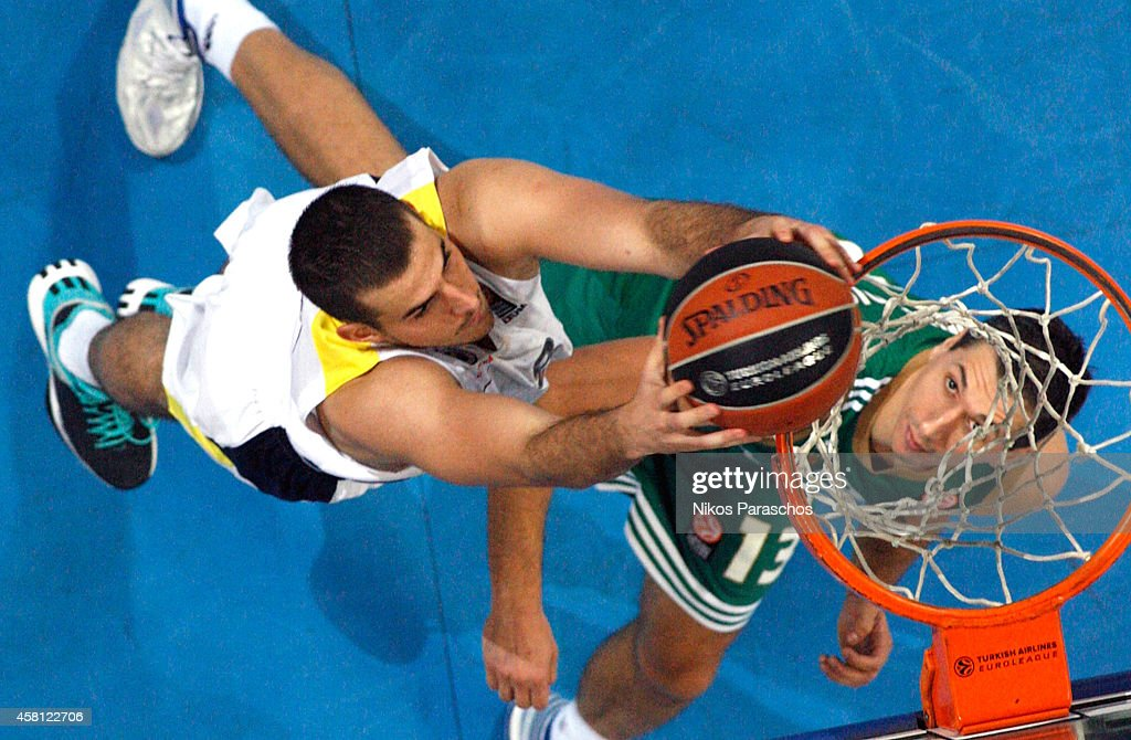 <a gi-track='captionPersonalityLinkClicked' href=/galleries/search?phrase=Nemanja+Bjelica&family=editorial&specificpeople=5625698 ng-click='$event.stopPropagation()'>Nemanja Bjelica</a>, #8 of Fenerbahce Ulker Istanbul competes with Dimitris Diamantidis, #13 of Panathinaikos Athens during the 2014-2015 Turkish Airlines Euroleague Basketball Regular Season Date 3 game between Panathinaikos Athens v Fenerbahce Ulker Istanbul at Olympic Sports Center Athens on October 30, 2014 in Athens, Greece.