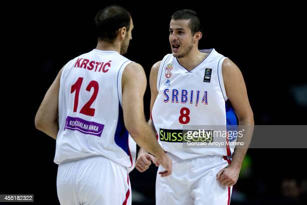 Nemanja Bjelica of Serbia celebrates with his teammate Nenad Krstic during the 2014 FIBA World Basketball Championship quarter final match between...