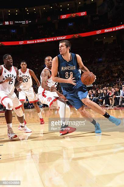 Nemanja Bjelica of the Minnesota Timberwolves drives to the basket against the Toronto Raptors on October 12 2015 at the Air Canada Centre in Toronto...