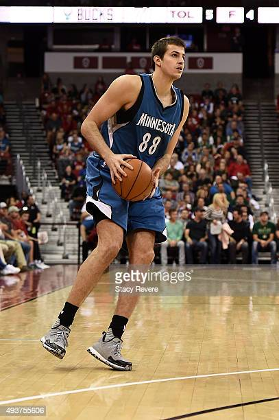 Nemanja Bjelica of the Minnesota Timberwolves handles the ball during a preseason game against the Milwaukee Bucks at the Kohl Center on October 20...