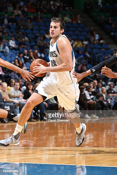 Nemanja Bjelica of the Minnesota Timberwolves handles the ball against the Milwaukee Bucks during a preseason game on October 23 2015 at Target...