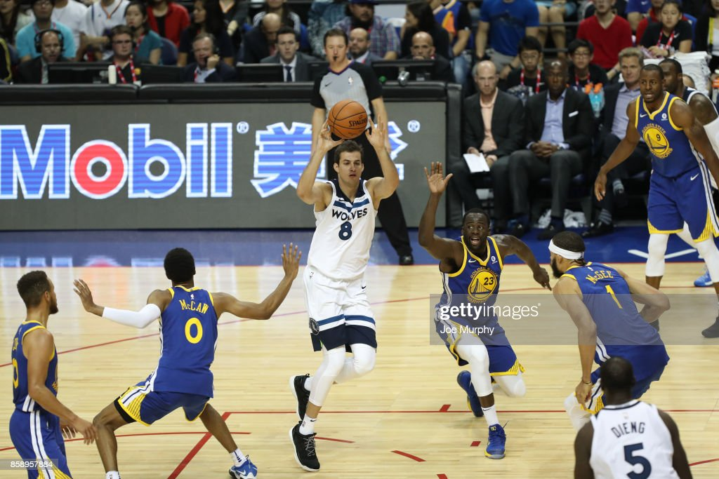 Nemanja Bjelica #8 of the Minnesota Timberwolves passes against the Golden State Warriors as part of the 2017 Global Games - China on October 8, 2017 at the Mercedes Benz Arena in Shanghai, China.