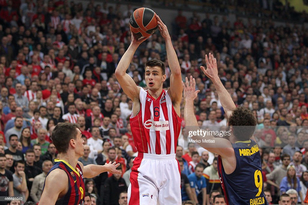 Nemanja Dangubic, #6 of Crvena Zvezda Telekom Belgrade competes with <a gi-track='captionPersonalityLinkClicked' href=/galleries/search?phrase=Marcelinho+Huertas&family=editorial&specificpeople=740271 ng-click='$event.stopPropagation()'>Marcelinho Huertas</a>, #9 of FC Barcelona during the Turkish Airlines Euroleague Basketball Top 16 Date 11 game between Crvena Zvezda Telekom Belgrade v FC Barcelona at Kombank Arena on March 19, 2015 in Belgrade, Serbia.