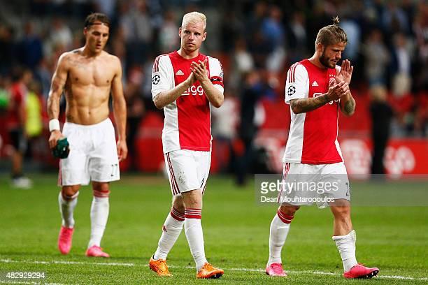 Nemanja Gudelj Davy Klaassen and Lasse Schone of Ajax look dejected after defeat in the third qualifying round 2nd leg UEFA Champions League match...