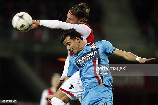 Nemanja Gudelj of AZ Ali Messaoud of Willem II during the Dutch Eredivisie match between AZ Alkmaar and Willem II Tilburg at AFAS stadium on February...