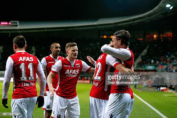 Nemanja Gudelj of AZ celebrates scoring the first goal of the game from the penalty spot with team mates during the Dutch Eredivisie match between AZ...