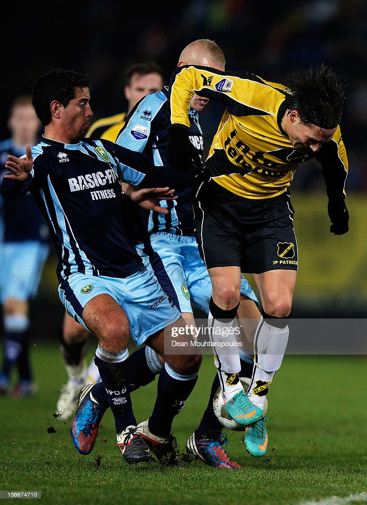 Nemanja Gudelj of NAC and Tom Beugelsdijk and Christian Supusepa of Den Haag battle for the ball during the Eredivisie match between NAC Breda and ADO Den Haag at the Rat Verlegh Stadium on November 23, 2012 in Breda, Netherlands.