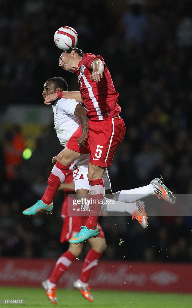 <a gi-track='captionPersonalityLinkClicked' href=/galleries/search?phrase=Nemanja+Gudelj&family=editorial&specificpeople=7480325 ng-click='$event.stopPropagation()'>Nemanja Gudelj</a> of Serbia gets above Danny Rose of England during the Under 21 European Championship Play Off between England U21 and Serbia U21 at Carrow Road on October 12, 2012 in Norwich, England.