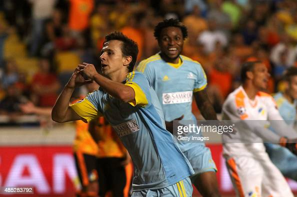 Nemanja Maksimovic of FC Astana celebrates scoring the equalising goal during UEFA Champions League play off between APOEL Nicosia and FC Astana at...