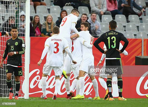 Nemanja Maksimovic of Serbia celebrates with team mates after scoring a goal during the FIFA U20 World Cup New Zealand 2015 Group D match between...