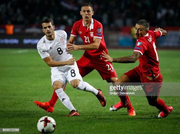 Nemanja Matic and Aleksandar Kolarov compete for the ball against Valeri Kazaishvili of Georgia FIFA 2018 World Cup Qualifier between Serbia and...