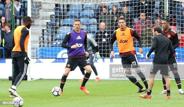 Nemanja Matic and Chris Smalling of Manchester United warm up ahead of the Premier League match between Huddersfield Town and Manchester United at...