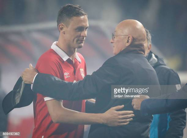 Nemanja Matic and head coach Slavoljub Muslin of Serbia celebrate their victory after FIFA 2018 World Cup Qualifier between Serbia and Georgia at...