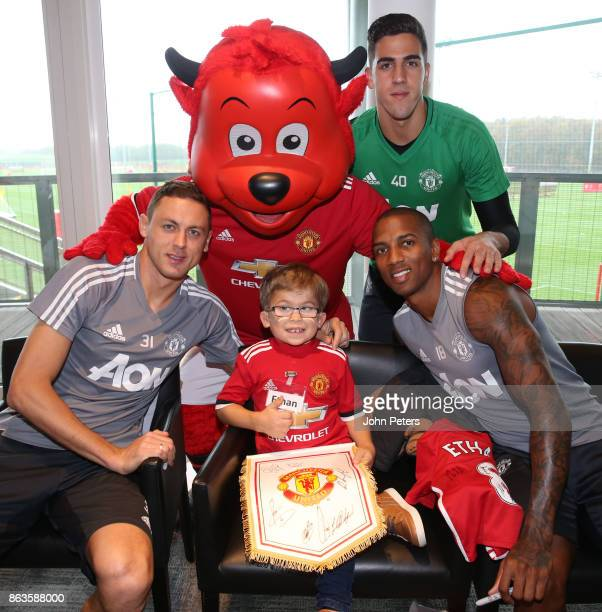 Nemanja Matic Ashley Young and Joel Pereira of Manchester United poses with Ethan 8 during a MU Foundation Dream Day at Aon Training Complex on...