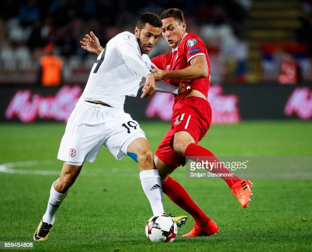 Nemanja Matic competes for the ball against Giorgi Aburjania of Georgia during the FIFA 2018 World Cup Qualifier between Serbia and Georgia at...