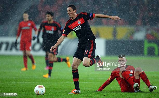 Nemanja Matic of Benfica is challenged Sven Bender of Leverkusen during the UEFA Europa League Round of 32 first leg between Bayer 04 Leverkusen and...