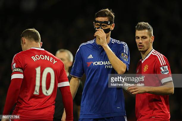 Nemanja Matic of Chelsea adjusts his protective face mask during the Barclays Premier League match between Manchester Untied and Chelsea at Old...
