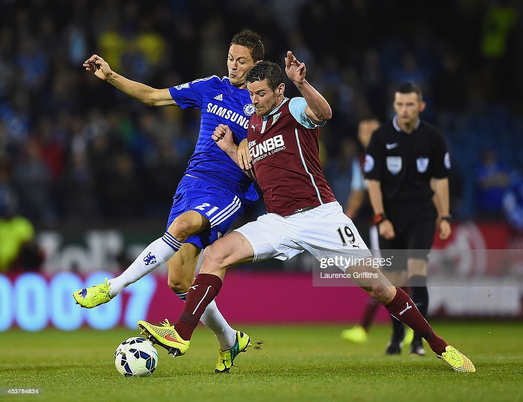 Nemanja Matic of Chelsea and Lukas Jutkiewicz of Burnley battle for the ball during the Barclays Premier League match between Burnley and Chelsea at Turf Moor on August 18, 2014 in Burnley, England.
