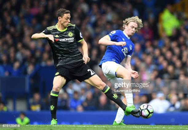 Nemanja Matic of Chelsea and Tom Davies of Everton compete for the ball during the Premier League match between Everton and Chelsea at Goodison Park...