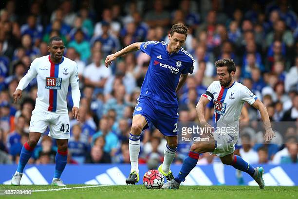 Nemanja Matic of Chelsea and Yohan Cabaye of Crystal Palace compete for the ball during the Barclays Premier League match between Chelsea and Crystal...