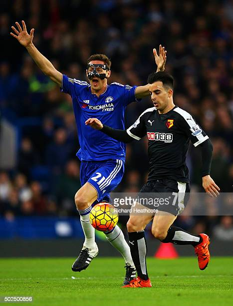Nemanja Matic of Chelsea appeals as Jose Manuel Jurado of Watford runs through during the Barclays Premier League match between Chelsea and Watford...