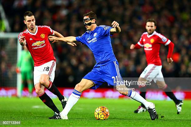 Nemanja Matic of Chelsea battles for the ball with Morgan Schneiderlin of Manchester United during the Barclays Premier League match between...