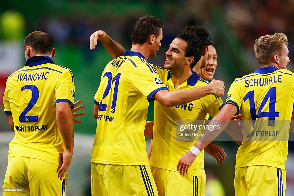 Nemanja Matic of Chelsea (21) celebrates with team mate Cesc Fabregas as he scores their first goal during the UEFA Champions League Group G match between Sporting Clube de Portugal and Chelsea FC at Estadio Jose Alvalade on September 30, 2014 in Lisbon, Portugal.
