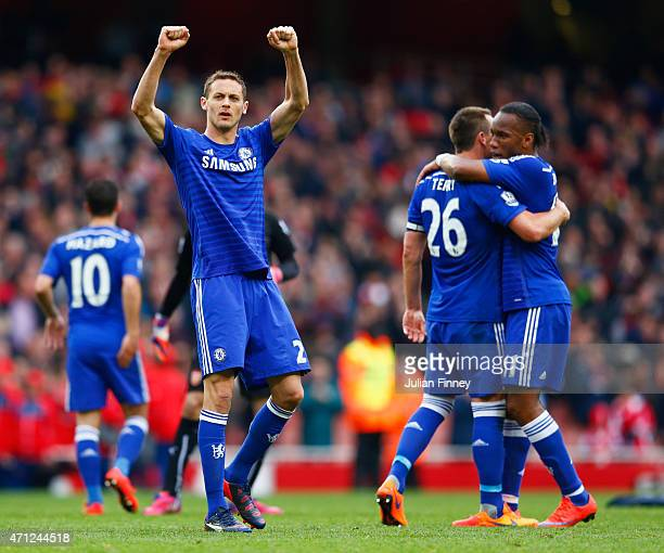 Nemanja Matic of Chelsea celebrates with team mates after the Barclays Premier League match between Arsenal and Chelsea at Emirates Stadium on April...