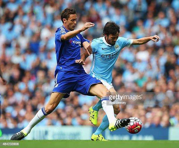 Nemanja Matic of Chelsea challenges David Silva of Manchester City during the Barclays Premier League match between Manchester City and Chelsea at...