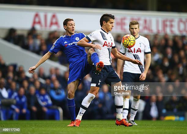 Nemanja Matic of Chelsea challenges Erik Lamela of Tottenham Hotspur during the Barclays Premier League match between Tottenham Hotspur and Chelsea...