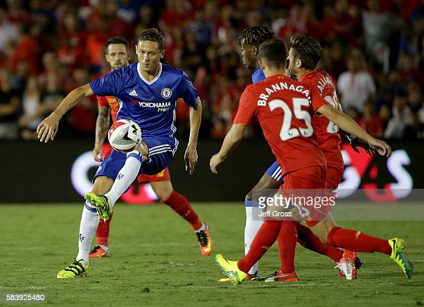 Nemanja Matic of Chelsea controls the ball while being pursued by Cameron Brannagan of Liverpool in the second half during the 2016 International...