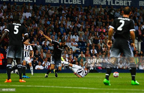 Nemanja Matic of Chelsea fouls Callum McManaman of West Bromwich Albion leading to a penalty during the Barclays Premier League match between West...