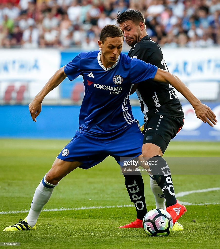 Nemanja Matic (L) of Chelsea in action against Boris Huttenbrenner (R) of WAC RZ Pellets during the international friendly match between WAC RZ Pellets and Chelsea F.C. at Worthersee Stadion on July 20, 2016 in Velden, Austria.