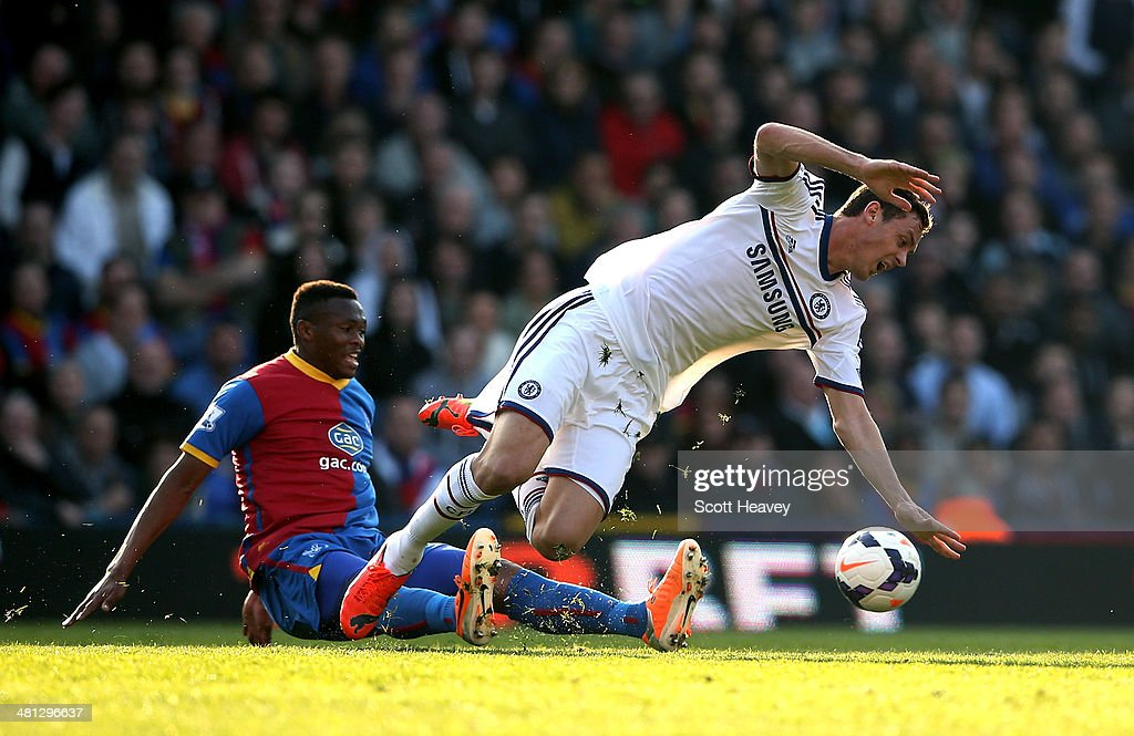 Nemanja Matic of Chelsea is brought down by <a gi-track='captionPersonalityLinkClicked' href=/galleries/search?phrase=Kagisho+Dikgacoi&family=editorial&specificpeople=4858795 ng-click='$event.stopPropagation()'>Kagisho Dikgacoi</a> of Crystal Palace during the Barclays Premier League match between Crystal Palace and Chelsea at Selhurst Park on March 29, 2014 in London, England.