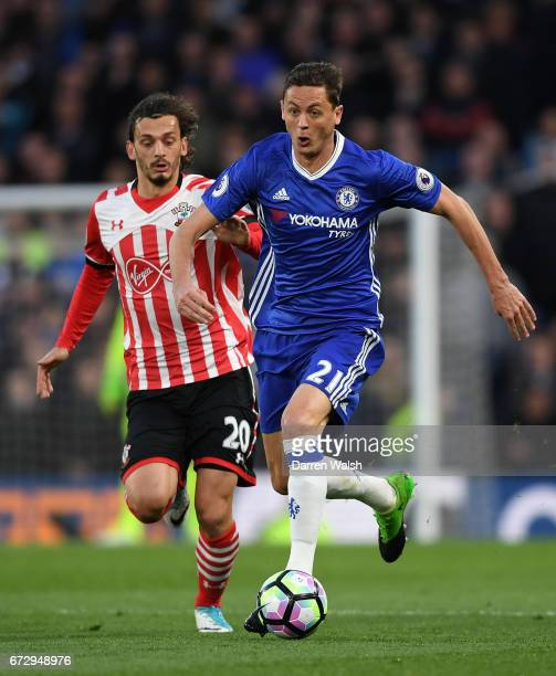 Nemanja Matic of Chelsea is chased by Manolo Gabbiadini of Southampton during the Premier League match between Chelsea and Southampton at Stamford...