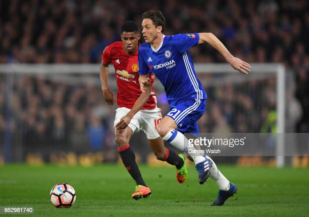 Nemanja Matic of Chelsea is chased by Marcus Rashford of Manchester United during The Emirates FA Cup QuarterFinal match between Chelsea and...