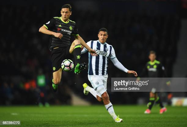 Nemanja Matic of Chelsea is put under pressure from Jose Salomon Rondon of West Bromwich Albion during the Premier League match between West Bromwich...