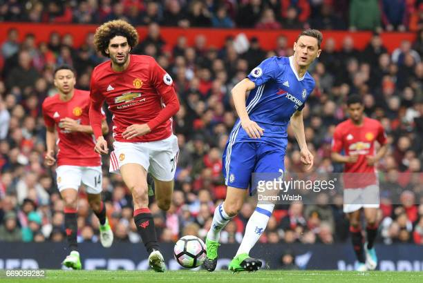 Nemanja Matic of Chelsea is put under pressure from Marouane Fellaini of Manchester United during the Premier League match between Manchester United...