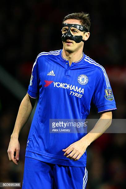 Nemanja Matic of Chelsea looks on wearing a face mask during the Barclays Premier League match between Manchester United and Chelsea at Old Trafford...