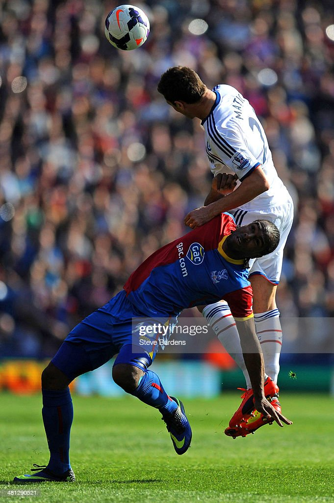 Nemanja Matic of Chelsea risea above <a gi-track='captionPersonalityLinkClicked' href=/galleries/search?phrase=Cameron+Jerome&family=editorial&specificpeople=815275 ng-click='$event.stopPropagation()'>Cameron Jerome</a> of Crystal Palace to head the ball clear during the Barclays Premier League match between Crystal Palace and Chelsea at Selhurst Park on March 29, 2014 in London, England.