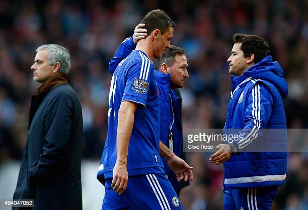 Nemanja Matic of Chelsea walks past Manager Jose Mourinho after being shown a red card during the Barclays Premier League match between West Ham...
