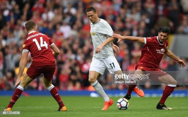 Nemanja Matic of Manchester United and Emre Can of Liverpool battle for the ball during the Premier League match between Liverpool and Manchester...