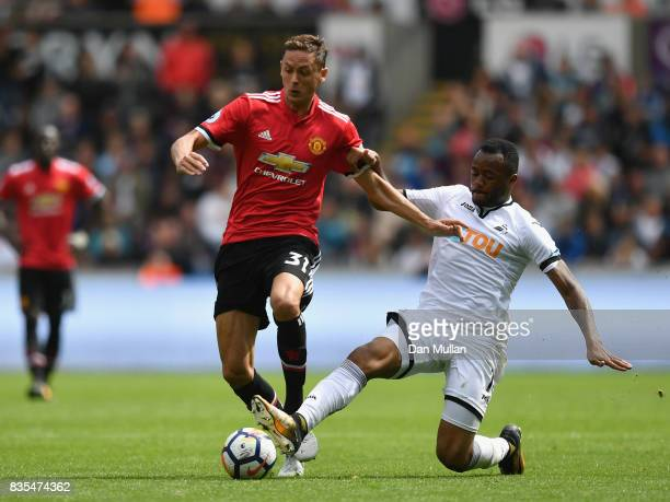 Nemanja Matic of Manchester United and Jordan Ayew of Swansea City battle for possession during the Premier League match between Swansea City and...