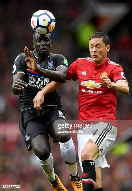 Nemanja Matic of Manchester United and Mamadou Sakho of Crystal Palace compete for the ball during the Premier League match between Manchester United...