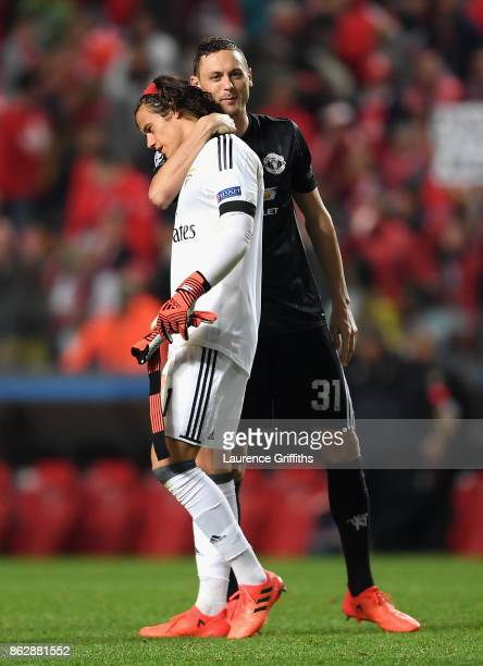 Nemanja Matic of Manchester United and Mile Svilar of Benfica embrace after the UEFA Champions League group A match between SL Benfica and Manchester...