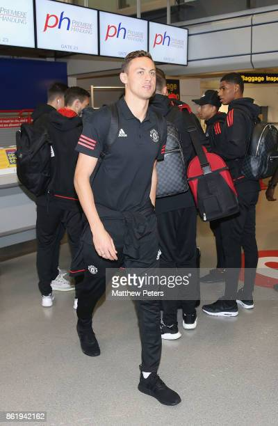 Nemanja Matic of Manchester United checks in ahead of their flight to Lisbon for the UEFA Champions League match against Benfica at Manchester...