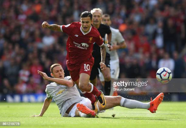 Nemanja Matic of Manchester United fouls Philippe Coutinho of Liverpool during the Premier League match between Liverpool and Manchester United at...