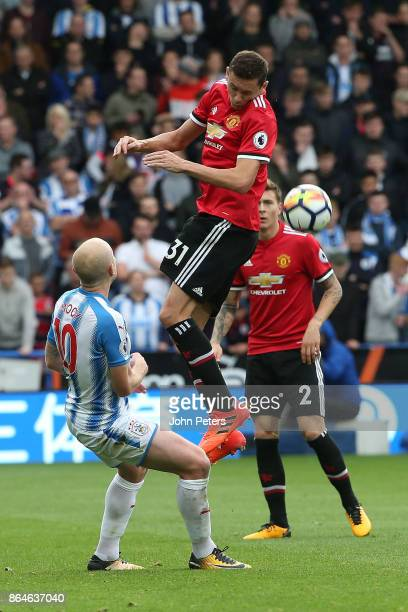 Nemanja Matic of Manchester United in action with Aaron Mooy of Huddersfield Town during the Premier League match between Huddersfield Town and...