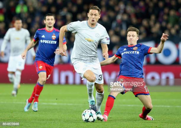 Nemanja Matic of Manchester United in action with Aleksandr Golovin of CSKA Moscow during the UEFA Champions League group A match between CSKA Moskva...