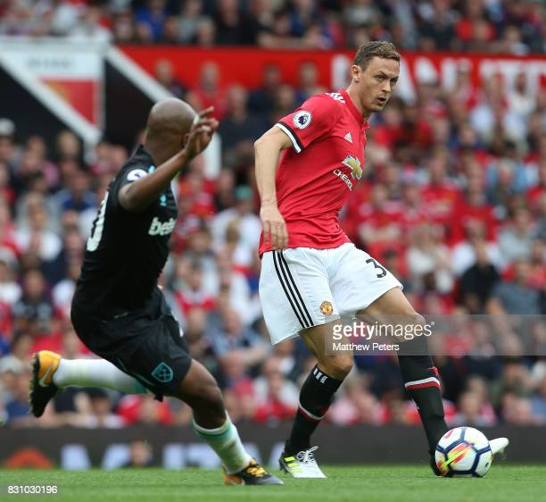 Nemanja Matic of Manchester United in action with Andre Ayew of West ham United during the Premier League match between Manchester United and West...